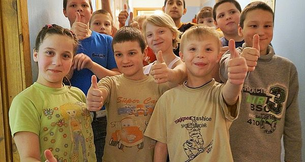 Thumbs up from the orphans in Eastern Europe